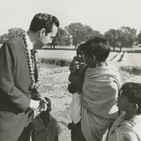 Photograph of Congressman Bob Dole with Indian children<br /><br />