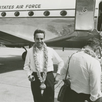Photograph of Congressman Bob Dole at Tiruchi Airport wearing a garland of roses<br /><br />