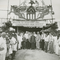 Photograph of members of the Congressional Delegation in front of ceremonial tent<br /><br />