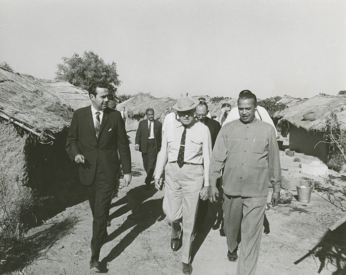 Photograph of the Congressional Delegation touring an Indian village<br /><br />